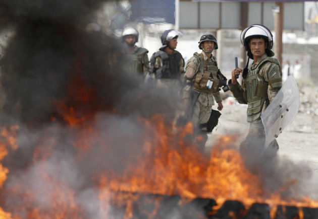 Afghan police stand by burning tires during a protest , Monday, Sept. 17, 2012 in Kabul, Afghanistan. Hundreds of Afghans burned cars and threw rocks at a U.S. military base as a demonstration against an anti-Islam film that ridicules the Prophet Muhammad turned violent in the Afghan capital early Monday. (AP Photo/Ahmad Jamshid)