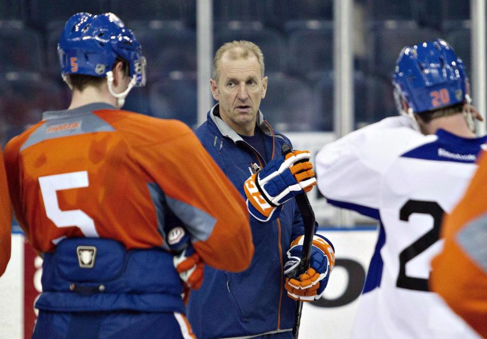In this Jan. 14, 2013, photo, Edmonton Oilers coach Ralph Krueger talks to players in Edmonton, Alberta. Krueger was fired Saturday, June 8, 2013, after leading the team to a 12th-place finish in the Western Conference in his lone season. (AP Photo/The Canadian Press, Jason Franson)