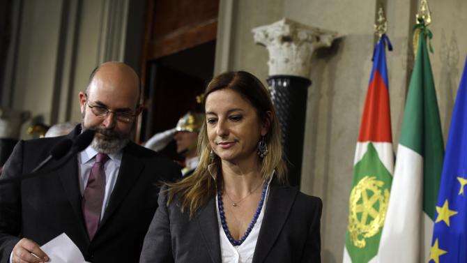 """Anti-establishment Five Star Movement's Vito Crimi, left, and Roberta Lombardi meet the journalists after talks with Italian President Giorgio Napolitano, in Rome's Quirinale presidential palace, Tuesday, April 23, 2013. President Giorgio Napolitano launches his unprecedented second term with accelerated consultations aimed at forming a new government. Napolitano, 87, has urged parties to quickly agree on a new government, chastising them for treating the notion of a political alliance as a """"horror"""" and urging them to face the reality that no party in Feb. 24-25 elections won control of both houses. (AP Photo/Gregorio Borgia)"""
