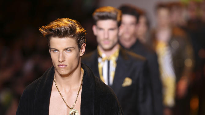 Models wear creations of the Versace men's Spring-Summer 2014 collection, part of the Milan Fashion Week, unveiled in Milan, Italy, Saturday, June 22, 2013. (AP Photo/Luca Bruno)