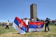 Serbians wave national flags as they attend a rally marking a historic battle at Gazimestan, near Pristina on June 28. The ceremony marked the 623rd anniversary of the 1389 Battle of Kosovo, where the Serbian army was defeated by the Ottoman Empire. Serbia's new government has been sworn in after the new premier vowed to focus on EU integration, continuing talks with breakaway Kosovo