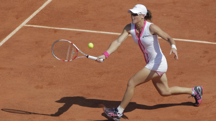 Australia's Samantha Stosur returns in her first round match against Britain's Elena Baltacha at the French Open tennis tournament in Roland Garros stadium in Paris, Sunday May 27, 2012. (AP Photo/Bernat Armangue)