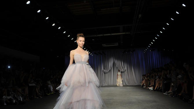 The Christian Siriano Spring 2013 collection is modeled during Fashion Week in New York, Saturday Sept 8, 2012. (AP Photo/Stephen Chernin)