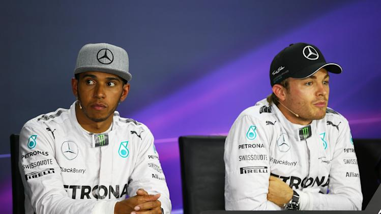 Teammates Lewis Hamilton of Great Britain and Mercedes GP and Nico Rosberg of Germany and Mercedes GP speak to the media following qualifying ahead of the Canadian Formula One Grand Prix at Circuit Gilles Villeneuve on June 7, 2014 in Canada
