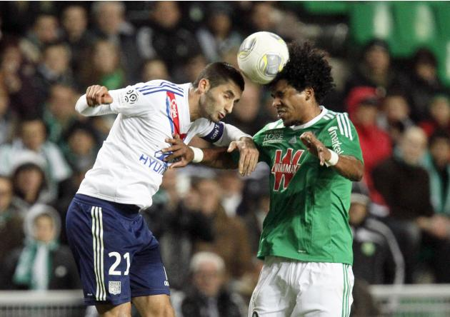 Gonalons of Olympique Lyon challenges Brandao of St Etienne during their French Ligue 1 soccer match at the Geoffroy Guichard stadium