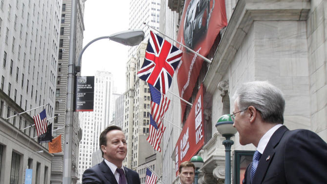 British Prime Minister David Cameron, left, is greeted by Jeff Eubank, NYSE senior vice-president of global affairs, as he arrives for a visit to the New York Stock Exchange Thursday, March 15, 2012. (AP Photo/Richard Drew)