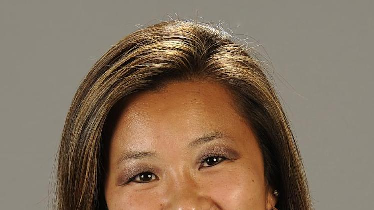 This undated photo provided by Cal State Fullerton on Monday, Feb. 4, 2013, shows Cal State Fullerton assistant women's NCCA college basketball coach Monica Quan in Fullerton, Calif. Quan and her fiance Keith Lawrence were found shot to death Sunday night on the top floor of a parking structure at the complex, police said. (AP Photo/Cal State Fullerton)