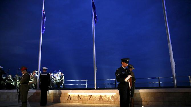 Australian and New Zealand guard of honour stand in formation at a memorial during a dawn service at the ANZAC Commemorative Site in ANZAC Cove, Gallipoli