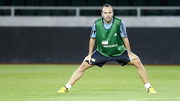 Spain national team player Andres Iniesta warms up during a training session at Boris Paichadze stadium in Tbilisi (Reuters)