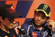 Yamaha Moto GP rider Valentino Rossi (R) of Italy looks to Honda MotoGP rider Marc Marquez of Spain during a news conference for the Catalan Grand Prix in Montmelo circuit, near Barcelona  June 13, 2013. The Catalan Grand Prix will run over the coming weekend. REUTERS/Gustau Nacarino (SPAIN - Tags: SPORT MOTORSPORT)