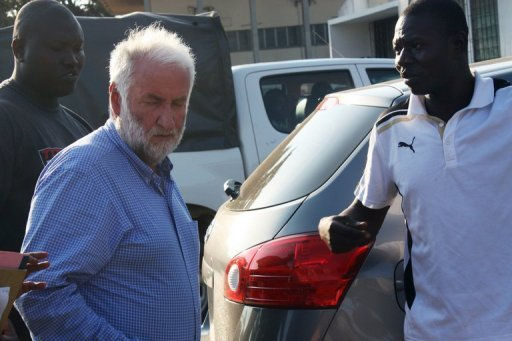 <p>Former head of French oil giant Elf Loik Le Floch-Prigent (L) arrives at a Togolese court in Lome on September 17. Le Floch-Prigent re-appeared before an investigating judge in the West African nation of Togo on Wednesday, two days after being charged in connection with a fraud probe.</p>