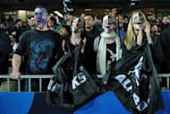 This file photo shows All Blacks fans cheering during the 2011 Rugby World Cup pool match between New Zealand and Tonga, in Auckland, last September. All Blacks' fans have reacted angrily to the New Zealand Rugby Union's (NZRU) controversial decision to sell commercial space on the front of the world champions' jersey