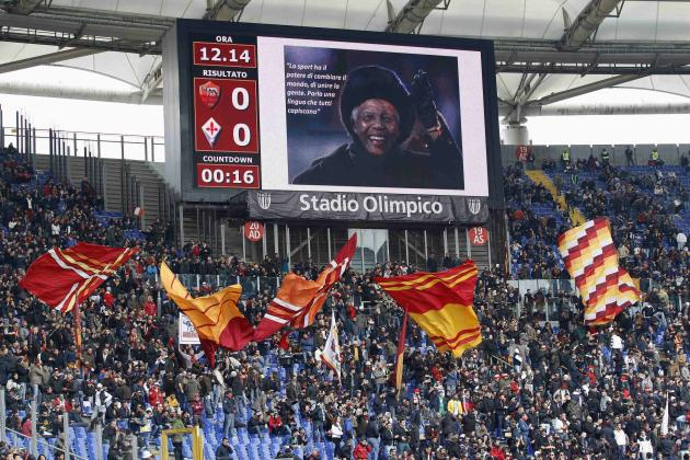 A scoreboard showing a picture of former South African President Mandela is seen before the Italian Serie A soccer match between AS Roma and Fiorentina, at the Olympic stadium in Rome