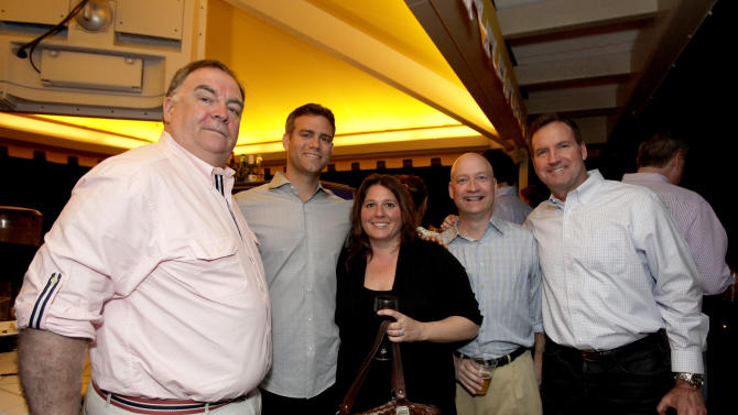 IMAGE DISTRIBUTED FOR WGN AMERICA - From left, WGN America Vice President Affiliate Sales East Ken Mullane, Chicago Cubs General Manager Theo Epstein, Time Warner Cable Vice President of Broadcasting Keely Bostock, WGN Sports Executive Producer Bob Vorwold, and Chicago Cubs Assistant General Manager Randy Bush celebrate at the WGN America Spring Training Weekend Welcome Reception at the Phoenician Resort in Scottsdale, AZ. on Thursday, March 21, 2013.  (Rick Scuteri/AP Images for WGN America)