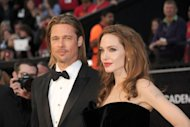 Brad Pitt and Angelina Jolie arrive at the Oscars in California in February. Pitt on Tuesday scotched rumours that his wedding to the other half of Hollywood's hottest couple, Angelina Jolie, would take place in August
