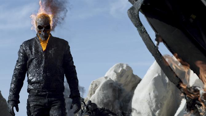 "FILE - This file image provided by Columbia Pictures shows Nicholas Cage in a scene from ""Ghost Rider: Spirit of Vengeance."" A lawsuit against comic book publisher Marvel Entertainment by a man who claims he owns the rights to the Ghost Rider character was reinstated on Tuesday, June 11, 2013. The 2nd U.S. Circuit Court of Appeals reversed a 2011 lower-court decision that dismissed the lawsuit brought by Gary Friedrich, who had sued in 2007, claiming he was owed a cut of the box office proceeds from a film version starring Nicolas Cage. (AP Photo/Columbia Pictures, File)"