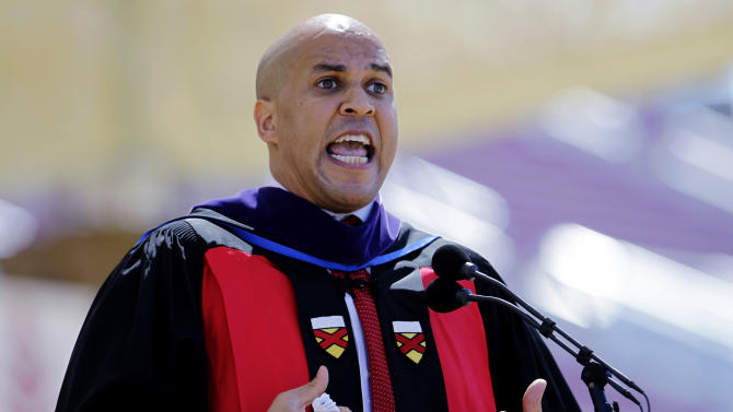 "FILE- In this June 17, 2012 file photo, Newark N.J. Mayor Cory Booker delivers a commencement address during graduation ceremonies on the Stanford University campus in Stanford, Calif. In a 1992 column in The Stanford Daily, his college newspaper, Booker wrote that he was ""disgusted by gays"" before a transformative experience with a gay peer counselor changed his views. (AP Photo/Paul Sakuma)"