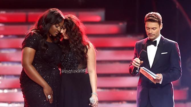 """FILE - This May 16, 2013 file photo shows Candice Glover, left, and Kree Harrison as they await the results to be read by host Ryan Seacrest at the """"American Idol"""" finale at the Nokia Theatre at L.A. Live in Los Angeles. Glover was announced the winner. (Photo by Matt Sayles/Invision/AP, file)"""