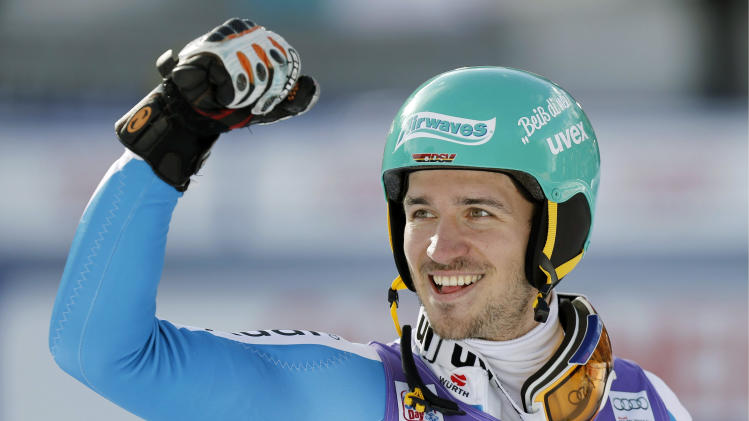 Felix Neureuther of Germany celebrates after winning the alpine skiing World Cup slalom race at the Lauberhorn in Wengen, Switzerland, Sunday, Jan. 20, 2013. (AP Photo/Keystone, Peter Klaunzer)