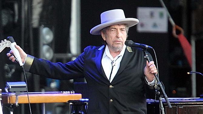 "FILE - This July 22, 2012 file photo shows U.S. singer-songwriter Bob Dylan performing on at ""Les Vieilles Charrues"" Festival in Carhaix, western France. A staff writer for The New Yorker has resigned and his latest book has been halted after he acknowledged inventing quotes by Bob Dylan. Jonah Lehrer released a statement Monday, July 30, through his publisher, Houghton Mifflin Harcourt, that some Dylan quotes appearing in his book ""Imagine: How Creativity Works"" did ""not exist."" Others were ""unintentional misquotations, or represented improper combinations of previously existing quotes."" (AP Photo/David Vincent, file)"