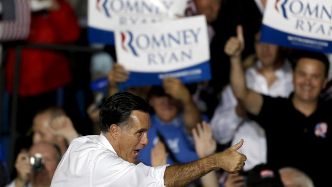 Republican presidential candidate, former Massachusetts Gov. Mitt Romney gives a thumbs up to someone in the crowd after speaking at a campaign event at the Wings Over the Rockies Air and Space Museum, Monday, Oct. 1, 2012, in Denver. (AP Photo/David Goldman)