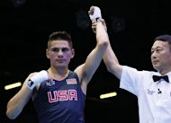 Jose Ramirez of the USA is awarded a 21-20 points victory over Rachid Azzedine of France in their first round Lightweight (60Kg) match of the London 2012 Olymipic Games at the Excel Arena in London