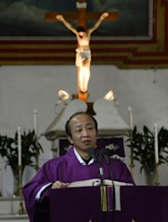 A priest is seen conducting mass for Chinese Catholics at the Cathedral of the Immaculate Conception in Beijing, on February 20, 2013. Experts estimate that there are as many as 12 million Catholics in China, with about half in congregations under the officially-administered Chinese Catholic Patriotic Association. The rest belong to non-sanctioned or so-called underground churches