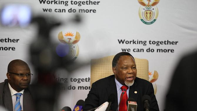 """South Africa's Deputy President Kgalema Motlanthe, right, speaks to foreign journalists at the Union Buildings in Pretoria, South Africa, on Friday, Nov. 30, 2012. Motlanthe says he is """"agonizing"""" over whether he would accept leading the governing African National Congress if he's chosen during the party's convention next month over President Jacob Zuma. Some local ANC groups have nominated Motlanthe to take over leadership of the ANC. Typically, whoever leads the ANC becomes the party's presidential candidate. Elections are slated for 2014. (AP Photo/Jon Gambrell)"""