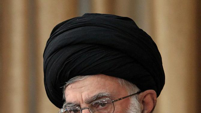 """FILE -- In this Sunday, Oct. 14, 2012 file photo released by an official website of the Iranian supreme leader's office, Supreme Leader Ayatollah Ali Khamenei listens to a speaker during a meeting in his tour in northeastern Iran. A religious decree issued by Iran's supreme leader banning nuclear weapons is binding for the Iranian government, the Foreign Ministry said Tuesday, Jan. 15, 2013, suggesting that the edict should end the debate over whether Tehran is pursuing atomic arms. Ministry spokesman Ramin Mehmanparast said the West must understand the significance of Ayatollah Ali Khamenei's edict for Iran, saying """"there is nothing higher than the exalted supreme leader's fatwa to define the framework for our activities in the nuclear field."""" (AP Photo/Office of the Supreme Leader, File)"""
