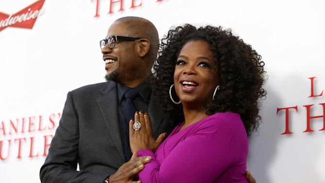 """FILE - In this Aug. 12, 2013 file photo, Forest Whitaker, left, and Oprah Winfrey arrive at the premiere of """"Lee Daniels' The Butler"""" in Los Angeles. When """"Lee Daniels' The Butler,"""" Winfrey's first feature since """"Beloved,"""" hit No. 1 in its debut last weekend, she brought out a purple Hula Hoop she uses for special occasions. (Photo by Matt Sayles/Invision/AP, File)"""