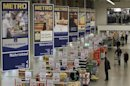 People shop at a cash and carry market of Germany's biggest retailer Metro AG in the western German city of Sankt Augustin
