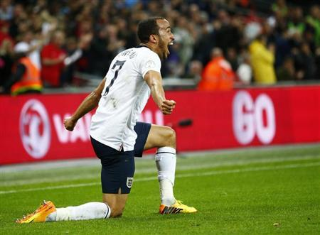 England's Andros Townsend celebrates scoring his team's third goal against Montenegro during their 2014 World Cup qualifying soccer match at Wembley Stadium in London, October 11, 2013. REUTERS/Darren