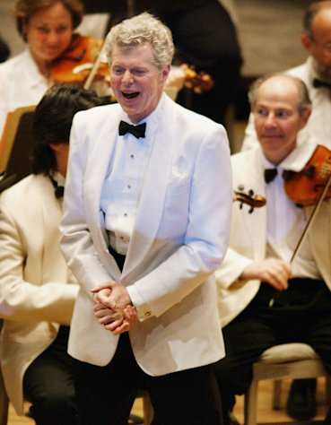 "FILE - This July 12, 2003 file photo shows pianist Van Cliburn after performing with the Boston Symphony Orchestra as the Orchestra plays ""Happy Birthday,"" on his 69th birthday at Tanglewood in Lenox, Mass. Cliburn, the internationally celebrated pianist whose triumph at a 1958 Moscow competition helped thaw the Cold War and launched a spectacular career that made him the rare classical musician to enjoy rock star status died early Wednesday, Feb. 27, 2013, at his Fort Worth home following a battle with bone cancer. He was 78. (AP Photo/Michael Dwyer, file)"