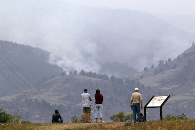 People watch from Bingham Hill as the High Park wildfire burns west of Fort Collins, Colo., on Tuesday, June 12, 2012. The fire which started on Saturday has burned more than 40,000 acres and one pers