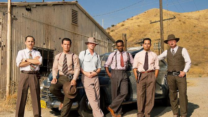 """This film image released by Warner Bros. Pictures shows, from left, Giovanni Ribisi as Officer Conwell Keeler, Josh Brolin, as Sgt. John O'Mara, Ryan Gosling as Sgt. Jerry Wooters, Anthony Mackie as Officer Coleman Harris, Michael Pena as Officer Navidad Ramirez and Robert Patrick as Officer Max Kennard in """"Gangster Squad."""" (AP Photo/Warner Bros. Pictures, Wilson Webb)"""