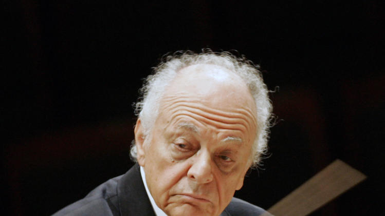 FILE - This Feb. 28, 2008 file photo shows Lorin Maazel, music director of the New York Philharmonic during a rehearsal in Seoul, South Korea. Maazel, whose prodigious career included seven years at the helm of the New York Philharmonic, died Sunday, July 13, 2014 from complications following pneumonia at his home in northern Virginia. He was 84. (AP Photo/ Lee Jin-man, File)