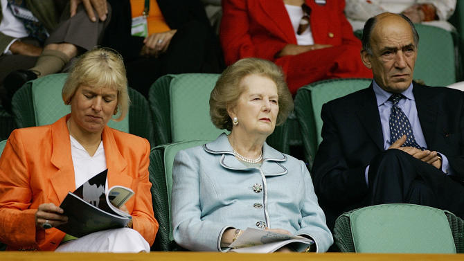 FILE - In this July 2, 2005, file photo, former British Prime Minister Margaret Thatcher, center, watches a seminfinal between Andy Roddick and Thomas Johansson on Centre Court at Wimbledon. At left is Thatcher's daughter Carol Thatcher and at right is General Sir Mike Jackson. The office of prime minister changed hands 16 times between Wimbledon titles for Fred Perry and Andy Murray. (AP Photo/Anja Niedringhaus, File)