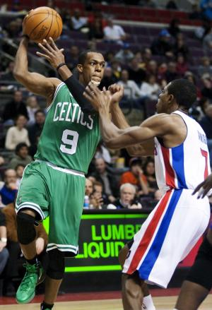 Boston Celtics guard Rajon Rondo (9) drives on Detroit Pistons guard Brandon Knight (7) in the first half of an NBA basketball game, Sunday, Feb. 19, 2012, in Auburn Hills, Mich. (AP Photo/Duane Burleson)