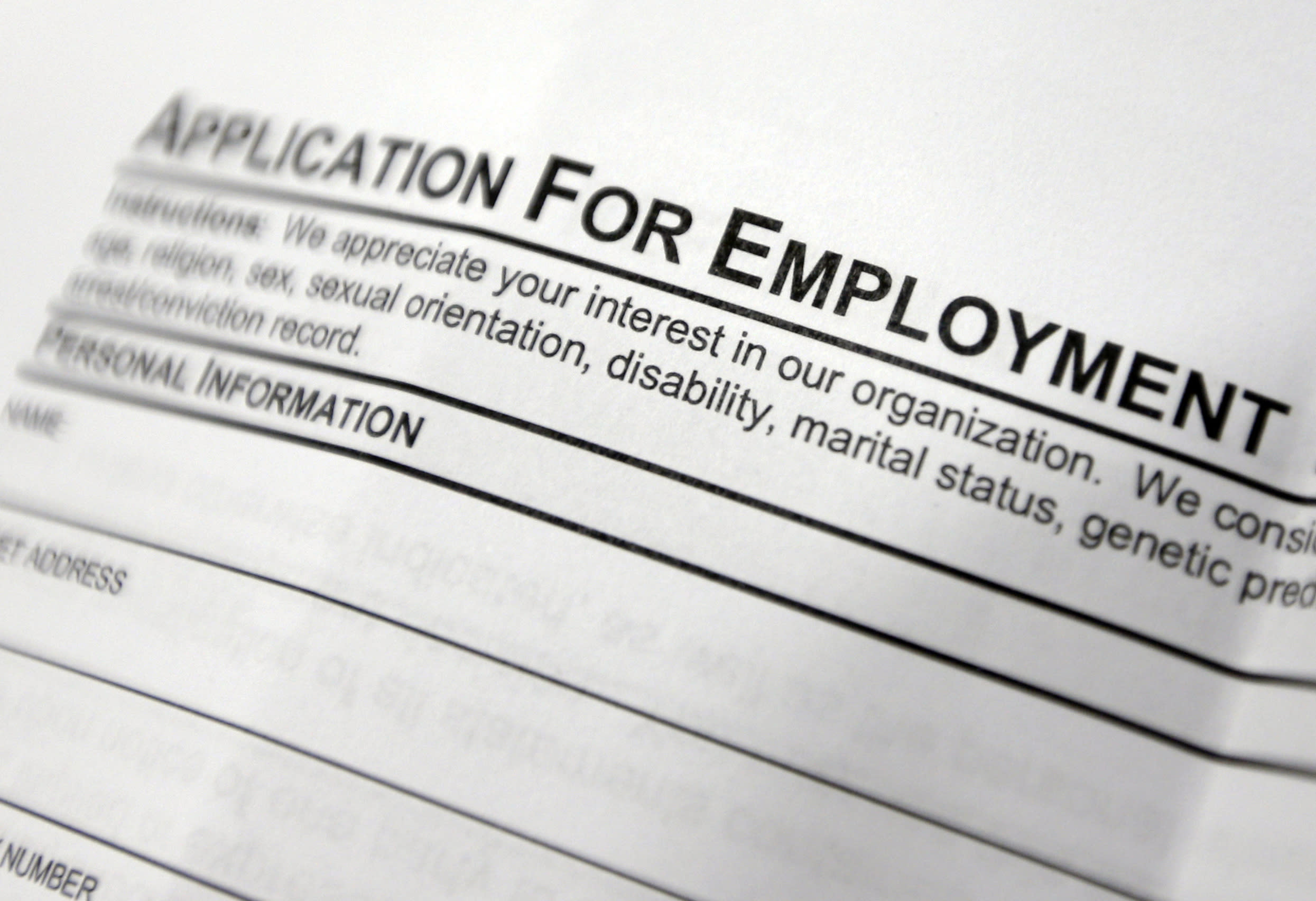 Applications for US jobless aid rise, but levels still low