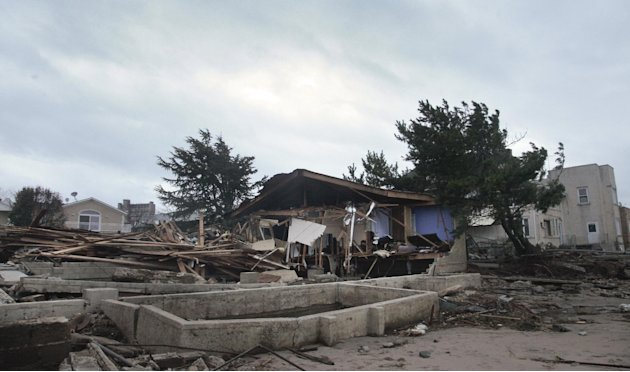 A beachfront house is completely destroyed in the aftermath of yesterday's surge from superstorm Sandy, Tuesday, Oct. 30, 2012, in Coney Island's Sea Gate community in New York. (AP Photo/Bebeto Matth