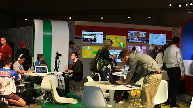 Journalists work and take breaks at the Google coffee bar in the media filing center for the Republican National Convention, Tuesday Aug. 28, 2012. (Torrey AndersonSchoepe/Yahoo! News)