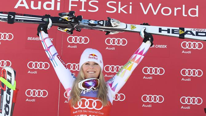 United States' Lindsey Vonn celebrates won the podium after winning the women's World Cup super-G   ski competition in Beaver Creek, Colo. on Wednesday Dec. 7, 2011. (AP Photo/Alessandro Trovati)
