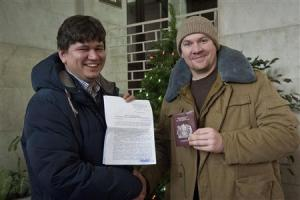 Greenpeace handout shows Greenpeace International activist Perrett posing with his lawyer Golubok after criminal case against him was dropped, in Saint Petersburg