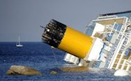 View of the Costa Concordia on January 14, 2012, after the cruise ship ran aground and keeled over off the Italian island of Giglio. South African salvage master Nick Sloane was flown to the island last year from New Zealand for the biggest ever salvage operation of a passenger ship.