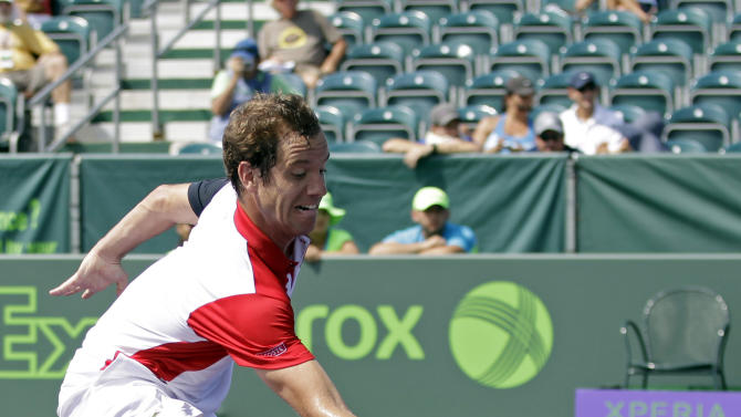 Richard Gasquet, of France, returns a shot to Olivier Rochus, of Belgium, during the Sony Open tennis tournament in Key Biscayne, Fla.,  Saturday, March 23, 2013. (AP Photo/Alan Diaz)