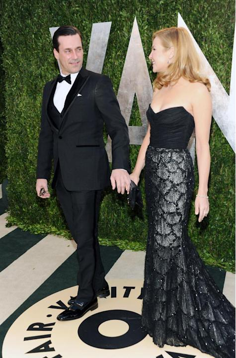 Actor Jon Hamm, left, and partner, actress Jennifer Westfeldt arrive at the 2013 Vanity Fair Oscars Viewing and After Party, Sunday, Feb. 24 2013 at the Sunset Plaza Hotel in West Hollywood, Calif. (P