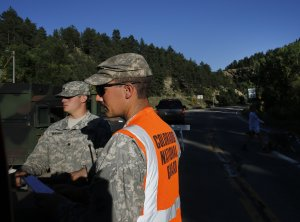 National Guard soldiers man a checkpoint on a closed…