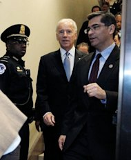 "US Vice President Joe Biden arrives with Representative Xavier Becerra (R) to the US Capitol to meet with reluctant House Democrats on January 1, 2013 in Washington, DC. After a day of twisting political drama, the US Congress was expected to finally endorse a deal to avert the ""fiscal cliff"" budget crisis that had threatened to unleash a new recession"