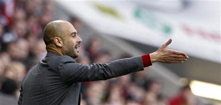 Bayern Munich's coach Pep Guardiola gestures during their German Bundesliga first division soccer match against Freiburg in Munich