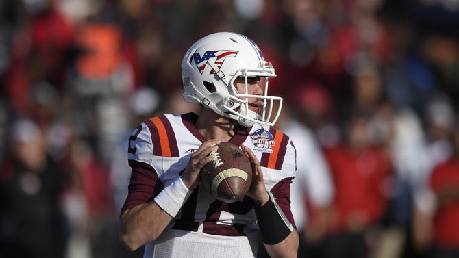 Virginia Tech quarterback Michael Brewer (12) looks to pass during the first half of the Military Bowl NCAA college football game against Cincinnati, Saturday, Dec. 27, 2014, in Annapolis, Md. (AP Photo/Nick Wass)